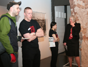 Student docents give tours to visitors.