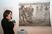 Visitor listens to oral history while viewing an archival photo.